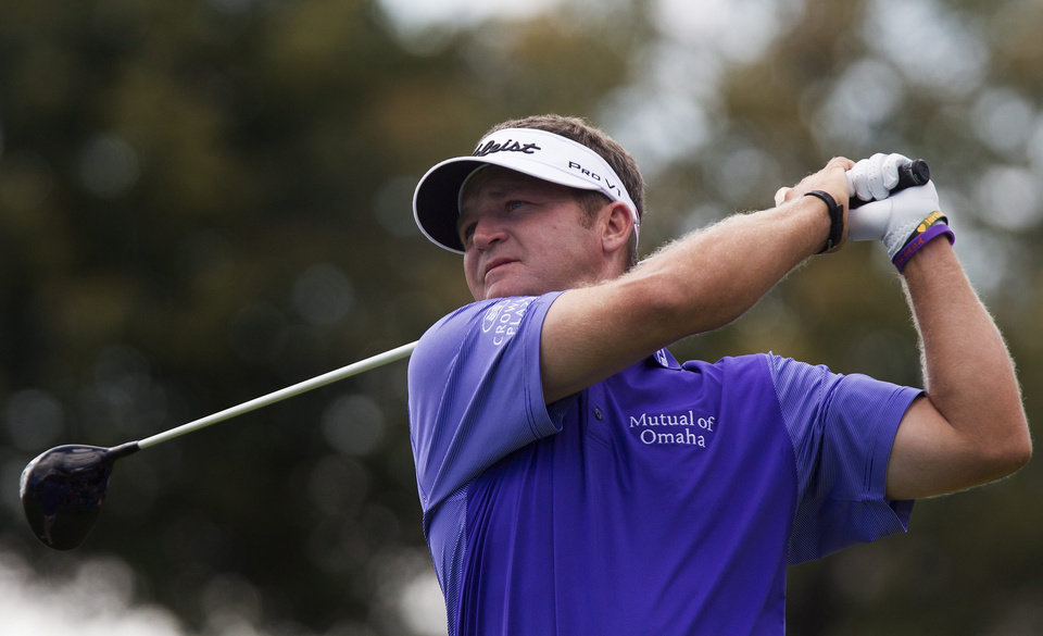 Photo - Jason Bohn, of the United States, tees off on the eighth hole during the final round of the RBC Canadian Open golf tournament at Glen Abbey Golf Club in Oakville, Ontario, Sunday, July 28, 2013. (AP Photo/The Canadian Press, Aaron Lynett)