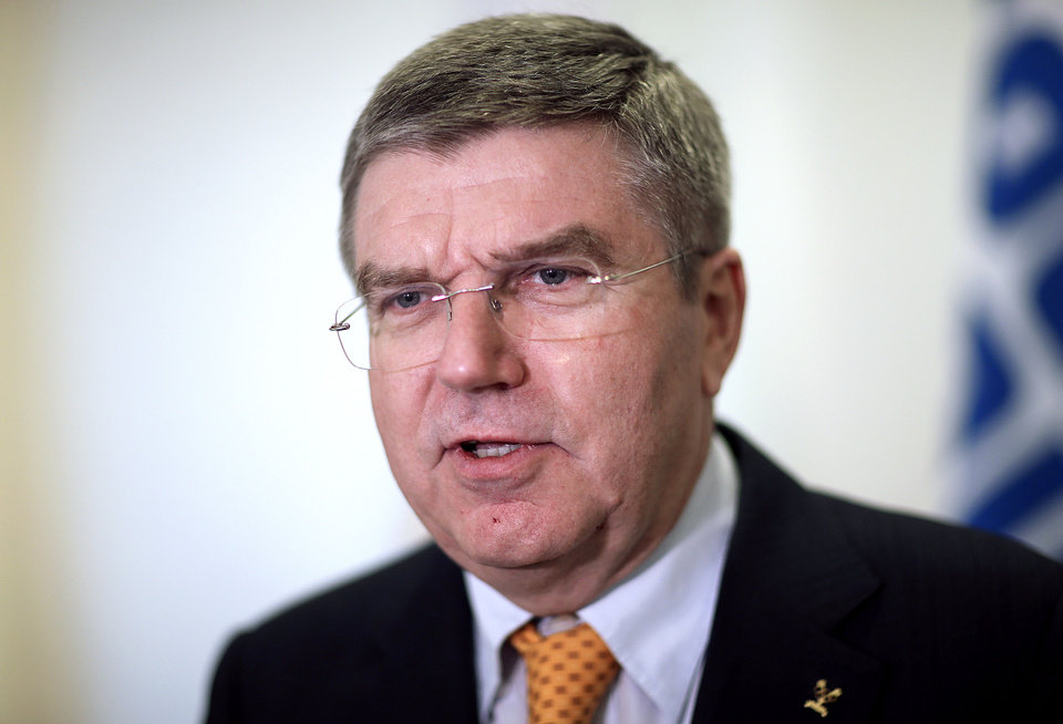 Photo - International Olympic Committee President Thomas Bach arrives for an executive board meeting at the 2014 Winter Olympics, Sunday, Feb. 2, 2014, in Sochi, Russia. (AP Photo/David Goldman)