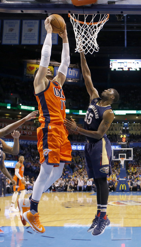 Photo - Oklahoma City's Enes Kanter (11) dunks the ball as New Orleans' E'Twaun Moore (55) defends during the NBA game between the Oklahoma City Thunder and the New Orleans Pelicans at the Chesapeake Energy Arena,  Sunday, Dec. 4, 2016. Photo by Sarah Phipps, The Oklahoman