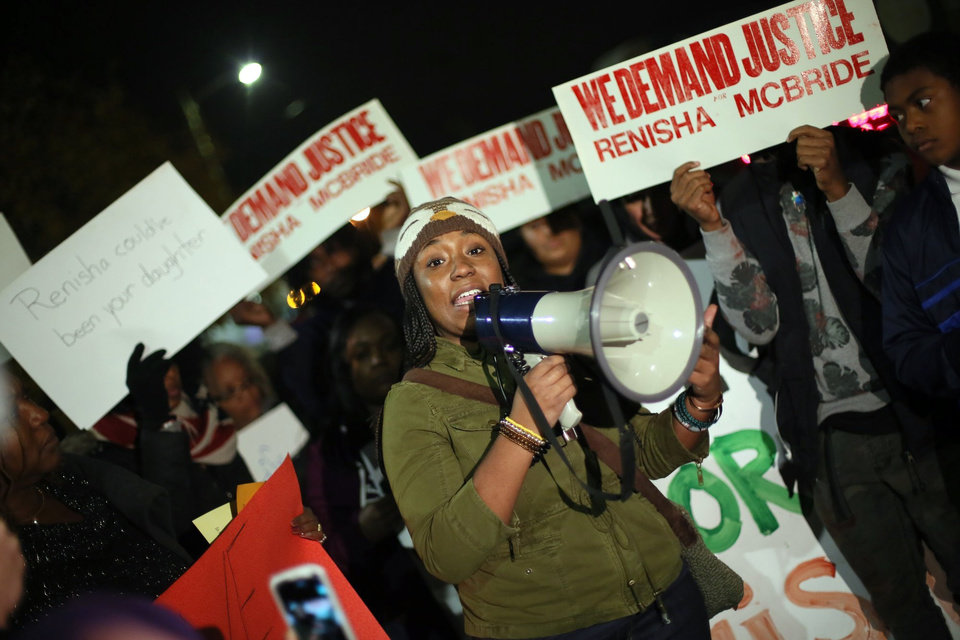FILE - In this Nov. 7, 2013, file photo, Siwatu-Salama Ra, 22, of Detroit, speaks to the crowd during a rally to protest the shooting death of Renisha McBride at the Dearborn Heights, Mich., Justice Center. Prosecutors announced Thursday, Nov. 14, 2013 that they have scheduled a news conference Friday in Detroit to announce whether they'll charge a suburban Detroit homeowner in the shooting death of McBride. (AP Photo/Detroit Free Press, Kimberly P. Mitchell) DETROIT NEWS OUT;  NO SALES