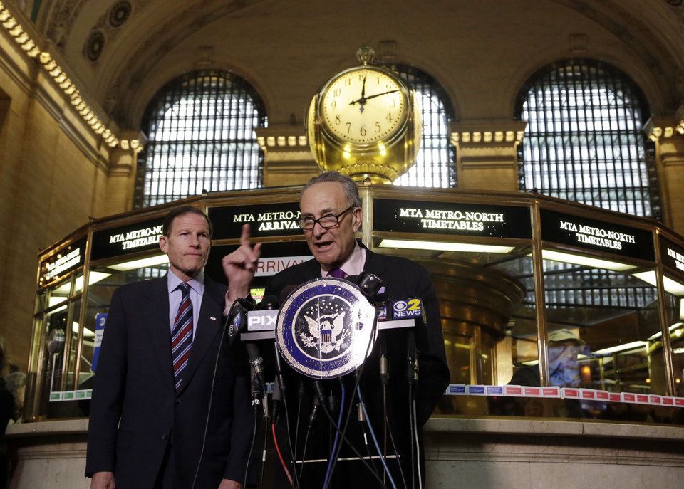 Photo - U.S. Sen. Richard Blumenthal, D-CT, left, and U.S. Sen. Charles Schumer, D-NY, comment during a news conference on a report by the Federal Railroad Administration about the Metro-North Railroad, at the information booth in New York's Grand Central Terminal, Friday, March 14, 2014. Metro-North commuter railroad has allowed an overemphasis on train times to