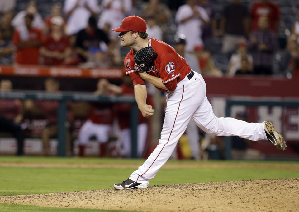 Photo - Los Angeles Angels closer Ryan Brasier throws the final pitches in the Angels 11-2 win over the Tampa Bay Rays in a baseball game in Anaheim, Calif., Monday, Sept. 2, 2013. (AP Photo/Reed Saxon)