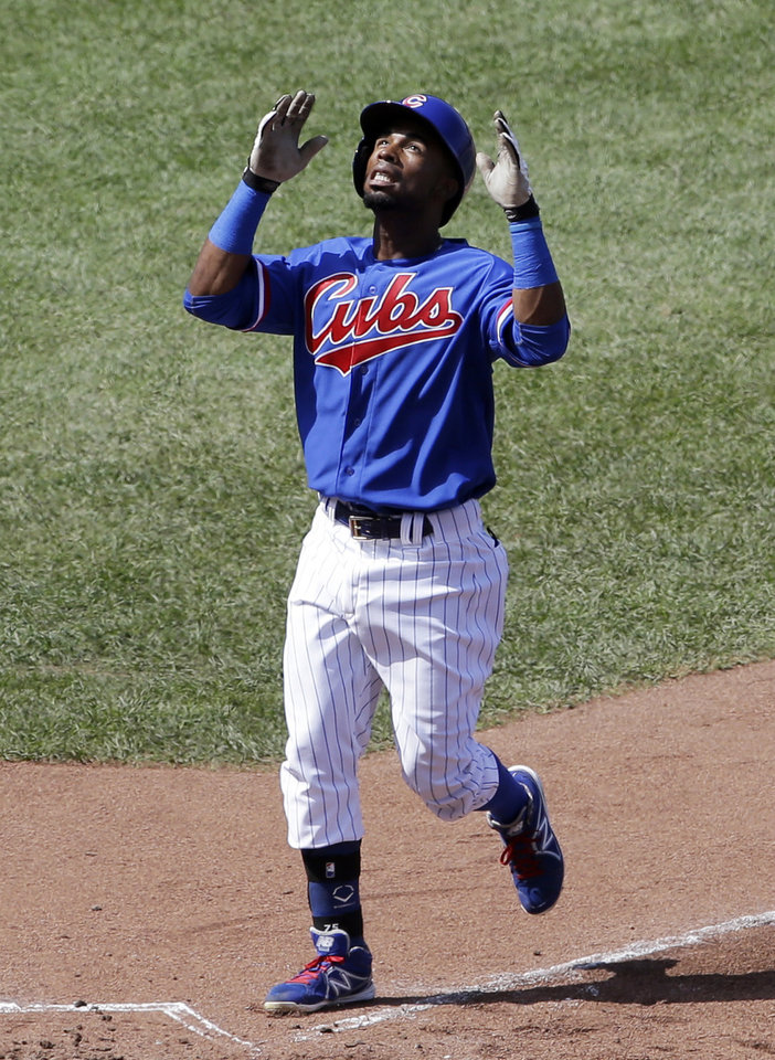 Photo - Chicago Cubs' Arismendy Alcantara celebrates after hitting a solo home run during the fifth inning of an interleague baseball game against the Baltimore Orioles in Chicago, Sunday, Aug. 24, 2014. (AP Photo/Nam Y. Huh)