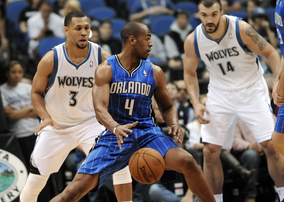 Orlando Magic's Arron Afflalo (4) checks the opposition as Minnesota Timberwolves' Nikola Pekovic, right, of Montenegro, and Brandon Roy, left, defend in the first half of an NBA basketball game Wednesday, Nov. 7, 2012, in Minneapolis. (AP Photo/Jim Mone)