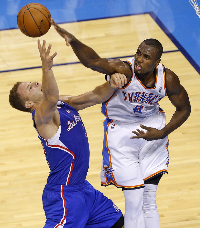 Photo - Oklahoma City's Serge Ibaka (9) blocks the shot of Los Angeles' Blake Griffin (32) during Game 1 of the Western Conference semifinals in the NBA playoffs between the Oklahoma City Thunder and the Los Angeles Clippers at Chesapeake Energy Arena in Oklahoma City, Monday, May 5, 2014. Photo by Bryan Terry, The Oklahoman