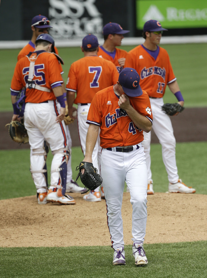 Photo - Clemson pitcher Matthew Crownover (44) walks to the dugout after being taken out during the fourth inning of an NCAA college baseball regional tournament game against Oregon Friday, May 30, 2014, in Nashville, Tenn. (AP Photo/Mark Humphrey)