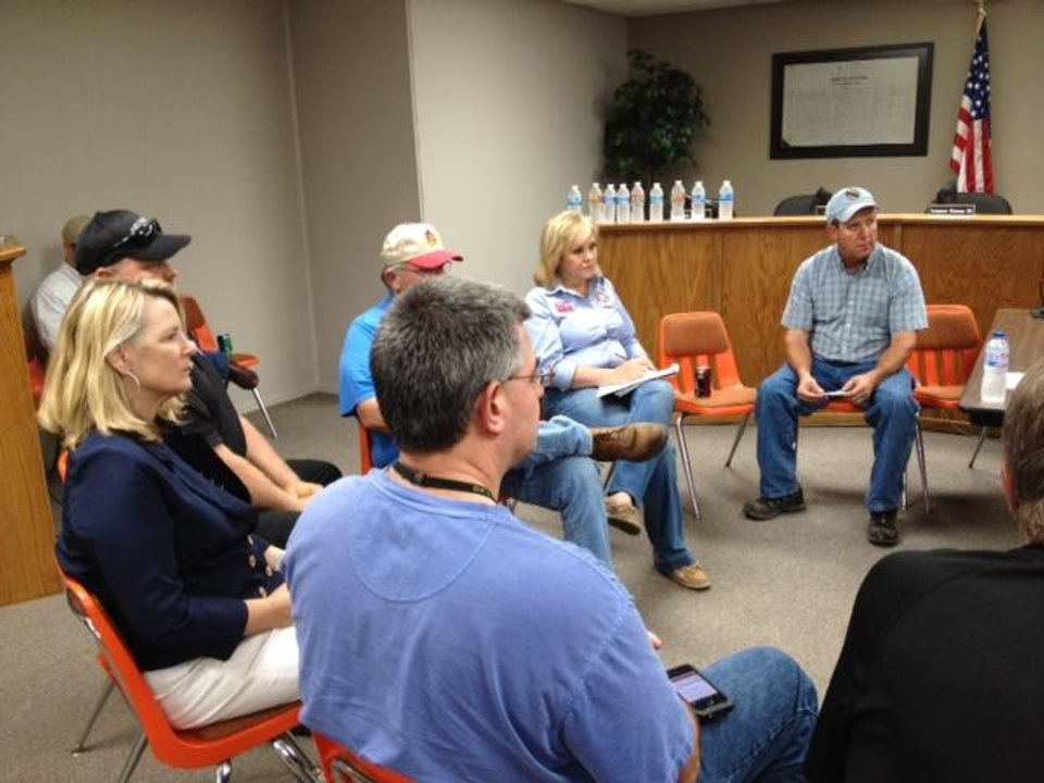 Photo - Gov. Mary Fallin sits in a Drumright emergency management meeting.  Sarah Phipps, The Oklahoman