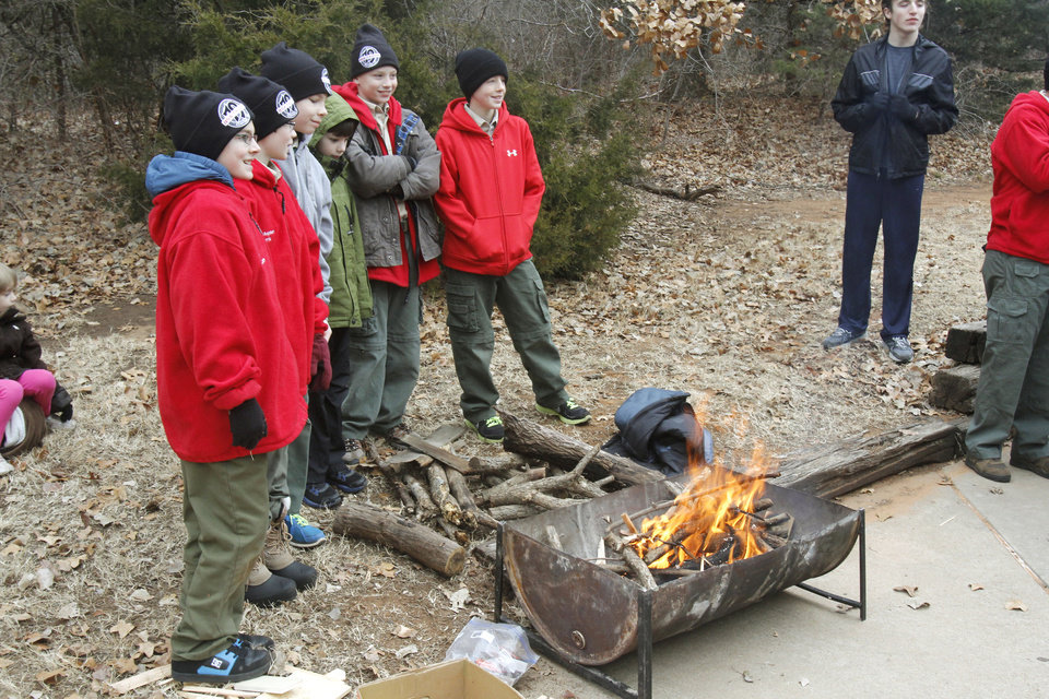 Boy Scouts from Troop 79 stand beside the campfire that they made during the Forever Edmond 5K and fun walk and run at Hafer Park in Edmond, OK, Saturday, January 12, 2013. The walk and run was held for the first time to raise money for American Foundation for Suicide Prevention.  By Paul Hellstern, The Oklahoman