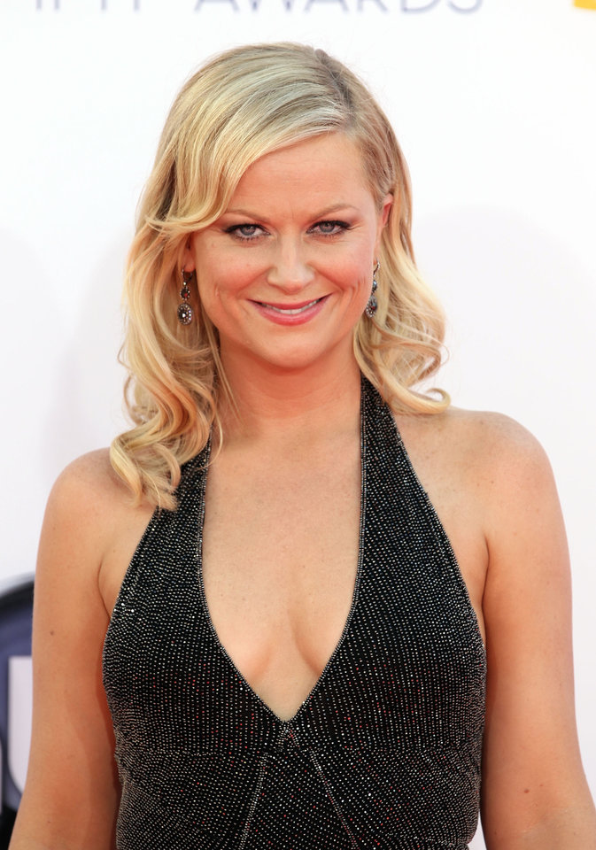 Photo -   FILE - In this Sept. 23, 2012 file photo, Amy Poehler arrives at the 64th Primetime Emmy Awards at the Nokia Theatre, in Los Angeles. The Hollywood Foreign Press Association, dick clark productions and NBC announced Monday, Oct. 15, 2012, that Tina Fey and Amy Poehler, have signed on to host the 70th annual ceremony after British comedian Ricky Gervais' three-year reign as the ceremony's acerbic master of ceremonies. The Golden Globes are set to air on NBC on Jan. 13, 2013. (Photo by Matt Sayles/Invision/AP, File)