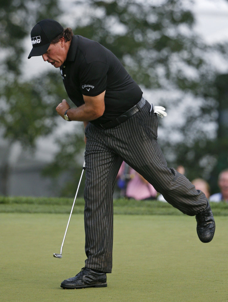 Photo - Phil Mickelson reacts after he saves par on the 12th hole during the final round of the PGA Championship golf tournament at Valhalla Golf Club on Sunday, Aug. 10, 2014, in Louisville, Ky. (AP Photo/Mike Groll)