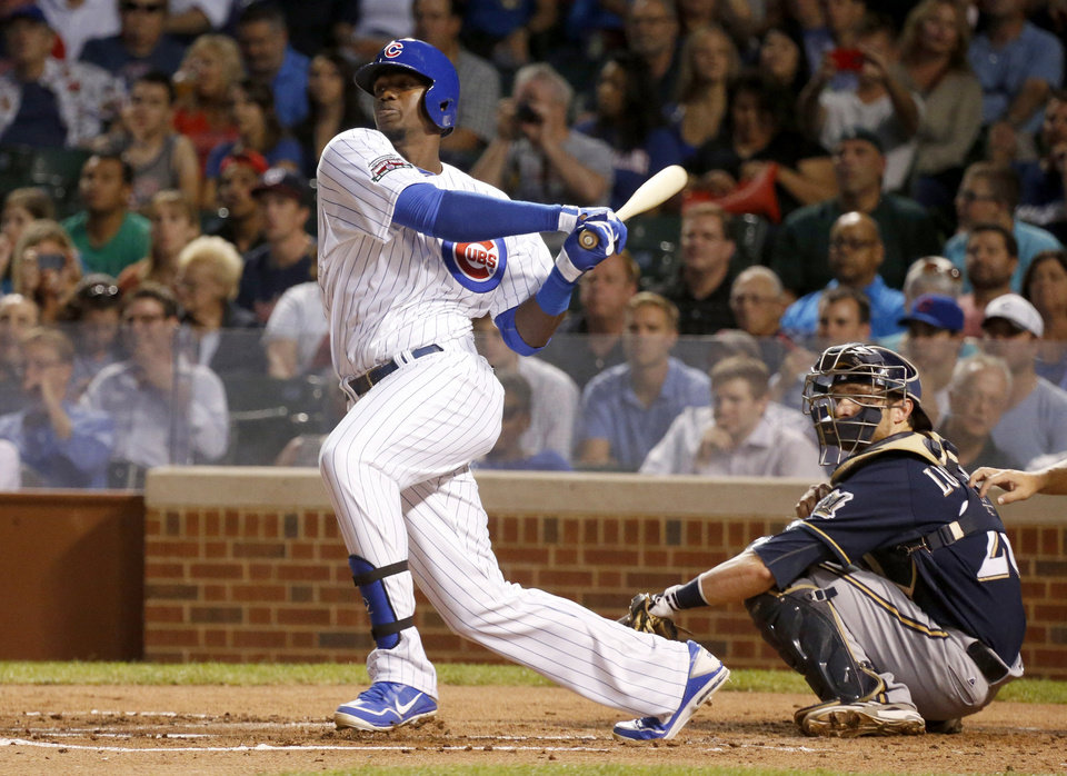 Photo - Chicago Cubs' Jorge Soler hits an RBI single off Milwaukee Brewers starting pitcher Yovani Gallardo, scoring Starlin Castro, during the first inning of a baseball game Tuesday, Sept. 2, 2014, in Chicago. (AP Photo/Charles Rex Arbogast)