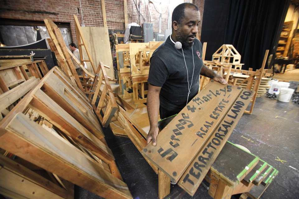 Photo - Pollard Theatre Artistic Director Jerome Stevenson works on the set for the Territorial Christmas production that opens after Thanksgiving in Guthrie, Wednesday, November 7, 2012.   Photo By David McDaniel/The Oklahoman