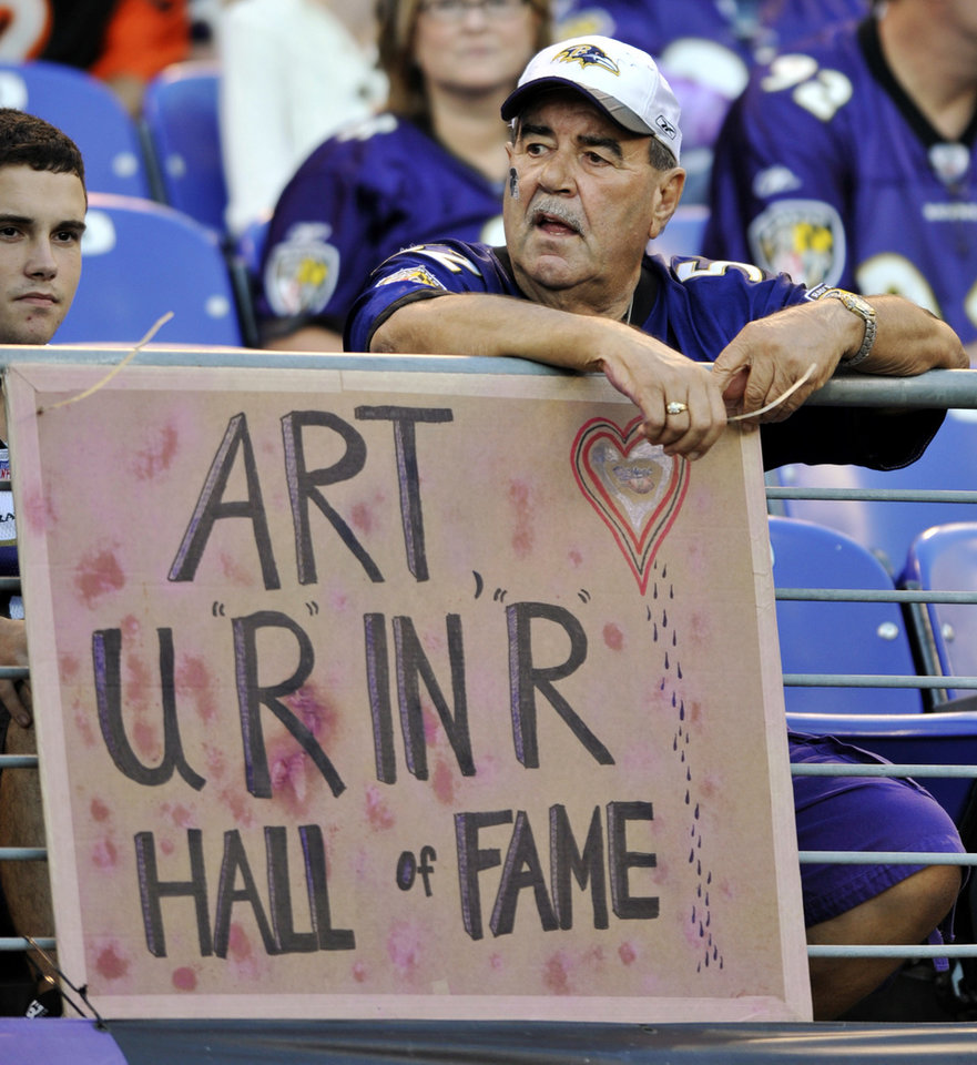 Photo -   A Baltimore Ravens fan displays a sign honoring former Ravens owner Art Modell before an NFL football game between the Ravens and the Cincinnati Bengals in Baltimore, Monday, Sept. 10, 2012. Modell died on Sept. 6. (AP Photo/Gail Burton)