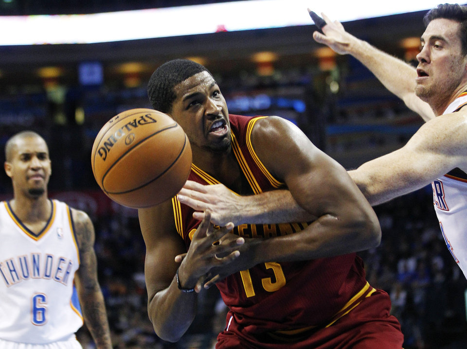 Oklahoma City Thunder forward Nick Collison, right, knocks the ball away from Cleveland Cavaliers forward Tristan Thompson (13) in the second quarter of an NBA basketball game in Oklahoma City, Sunday, Nov. 11, 2012. Thunder guard Eric Maynor watches at left. (AP Photo/Sue Ogrocki)