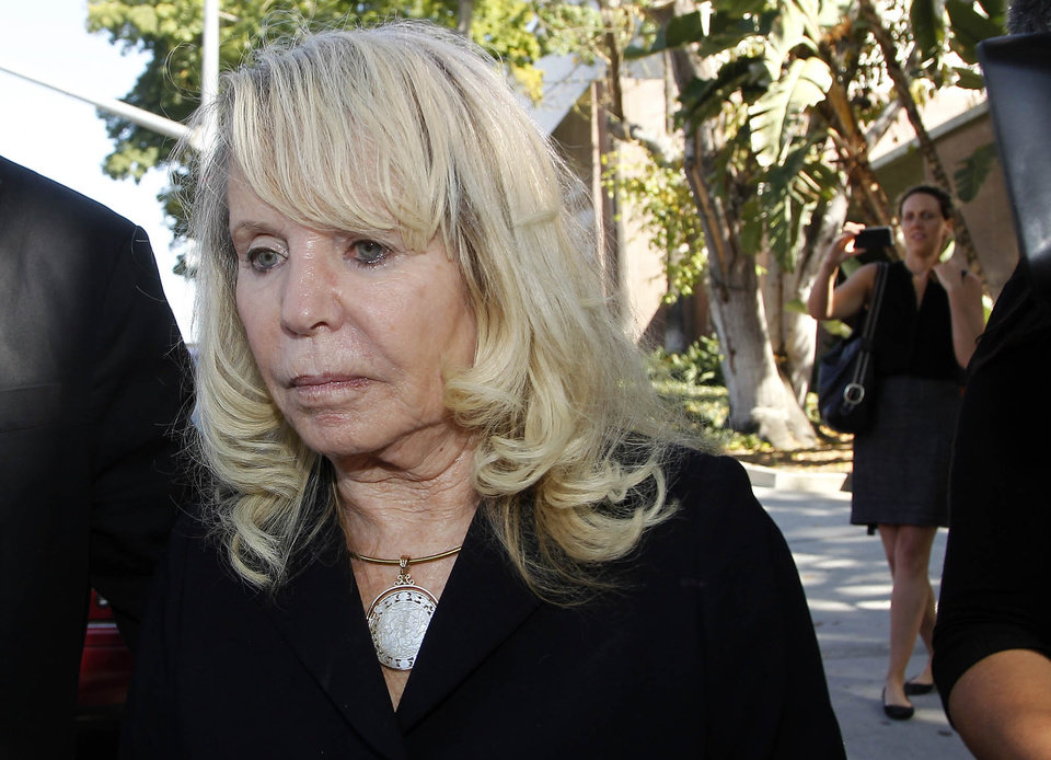 Photo - Shelly Sterling, the estranged wife of Los Angeles Clippers owner Donald Sterling, leaves a Los Angeles courthouse Monday, July 7, 2014. A jurisdictional issue delayed Monday's scheduled start of a trial focusing on whether Donald Sterling's estranged wife had the authority under terms of a family trust to unilaterally negotiate a $2 billion sale of the Los Angeles Clippers. (AP Photo/Nick Ut)