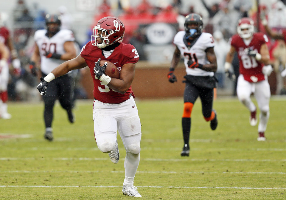 Photo - Oklahoma's Dimitri Flowers (36) runs after a catch in the second quarter during the Bedlam college football game between the Oklahoma Sooners (OU) and the Oklahoma State Cowboys (OSU) at Gaylord Family - Oklahoma Memorial Stadium in Norman, Okla., Saturday, Dec. 3, 2016. Photo by Nate Billings, The Oklahoman