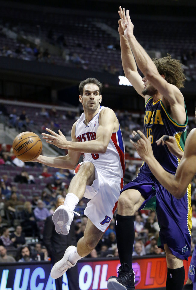 Detroit Pistons guard Jose Calderon, left, looks to pass the ball against New Orleans Hornets center Robin Lopez (15) in the first half of an NBA basketball game, Monday, Feb. 11, 2013, in Auburn Hills, Mich. (AP Photo/Duane Burleson)