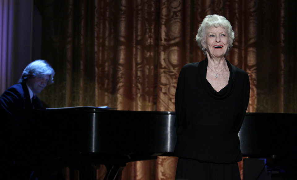 Photo - FILE - In this July 19, 2010 file photo shows actress Elaine Stritch performing at a White House Music Series event saluting Broadway in the East Room of the White House in Washington. Stritch died Thursday, July 17, 2014 at her home in Birmingham, Mich. She was 89. (AP Photo/Carolyn Kaster, File)