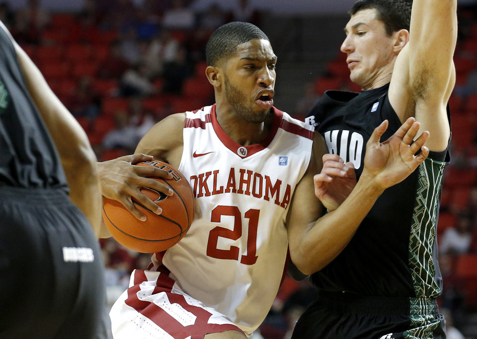 Photo - Oklahoma's Cameron Clark (21) goes past Ohio's Ivo Baltic (23) during a NCAA college basketball game between the University of Oklahoma (OU) and Ohio at the Lloyd Noble Center in Norman, Saturday, Dec. 29, 2012. Photo by Bryan Terry, The Oklahoman