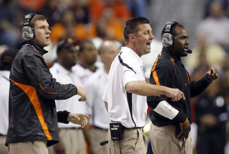 Photo - OSU head coach Mike Gundy argues a call during the Valero Alamo Bowl college football game between the Oklahoma State University Cowboys (OSU) and the University of Arizona Wildcats at the Alamodome in San Antonio, Texas, Wednesday, December 29, 2010. Photo by Sarah Phipps, The Oklahoman