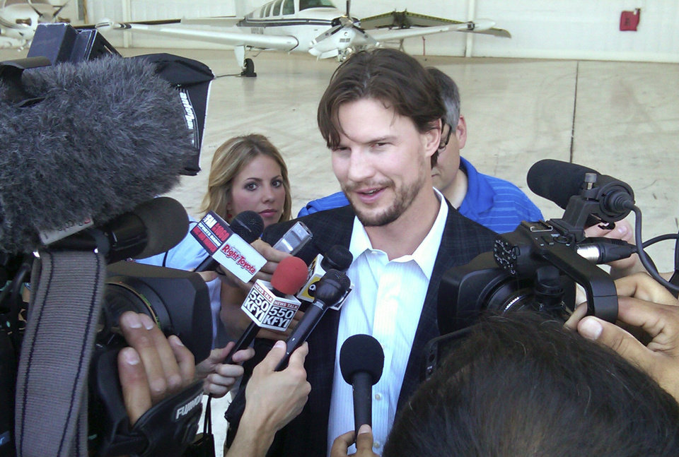 Phoenix Coyotes captain Shane Doan speaks to reporters at Sky Harbor International Airport on Tuesday, April 24, 2012, in Phoenix. The Coyotes wrapped up the first win for the franchise in an NHL hockey Stanley Cup playoff series in 25 years by beating the Chicago Blackhawks 4-0 on Monday. (AP Photo/John Marshall)