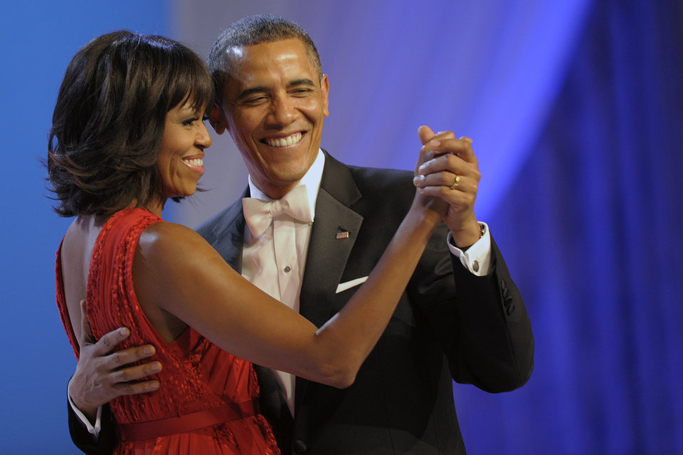 Photo - President Barack Obama dances with first lady Michelle Obama during The Inaugural Ball at the Washignton convention center during the 57th Presidential Inauguration in Washington, Monday, Jan. 21, 2013. (AP Photo/Cliff Owen)
