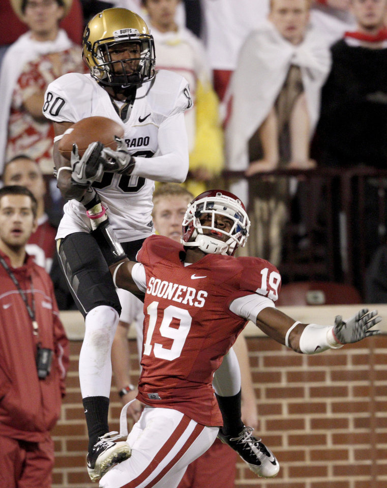 Photo - OU's Demontre Hurst breaks up a pass inteaded for olorado's Paul Richardson during the college football game between the University of Oklahoma (OU) Sooners and the University of Colorado Buffaloes at Gaylord Family-Oklahoma Memorial Stadium in Norman, Okla., Saturday, October 30, 2010. Photo by Bryan Terry, The Oklahoman