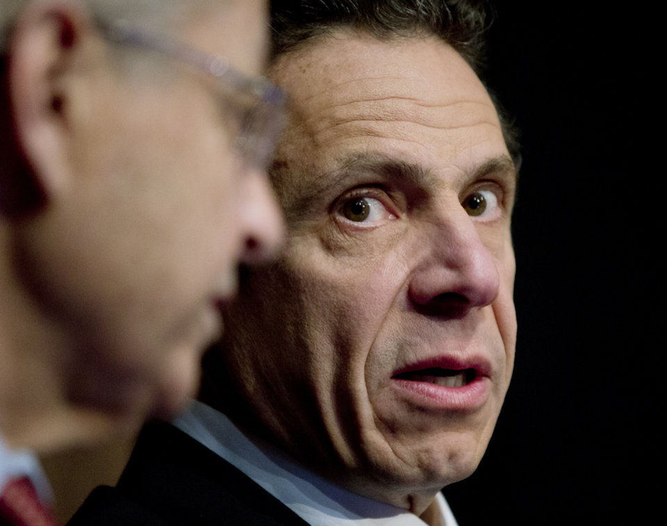 New York Gov. Andrew Cuomo, right, talks to Assembly Speaker Sheldon Silver, D-Manhattan, during the regional economical development council awards on Wednesday, Dec. 19, 2012 in Albany, N.Y. Economic development officials have announced a new round of more than $700 million of regional economic development incentives, following $785.5 million last year, all intended to keep or create jobs. (AP Photo/Mike Groll)