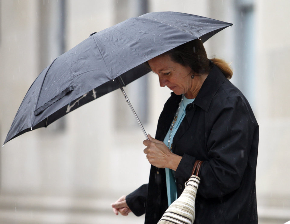 Photo -   Lora Haggard coms out of a federal courthouse in Greensboro, N.C., after testifying in the John Edwards campaign corruption trial Monday, May 14, 2012. On Monday, Haggard, who was in charge of campaign finance compliance for Edwards, testified that the money from heiress Rachel