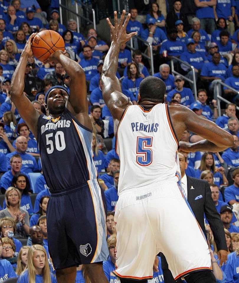 Photo - Zach Randolph (50) of Memphis shoots over Kendrick Perkins (5) of Oklahoma City in the second half during game one of the Western Conference semifinals between the Memphis Grizzlies and the Oklahoma City Thunder in the NBA basketball playoffs at Oklahoma City Arena in Oklahoma City, Sunday, May 1, 2011. Memphis won, 114-101. Photo by Nate Billings, The Oklahoman