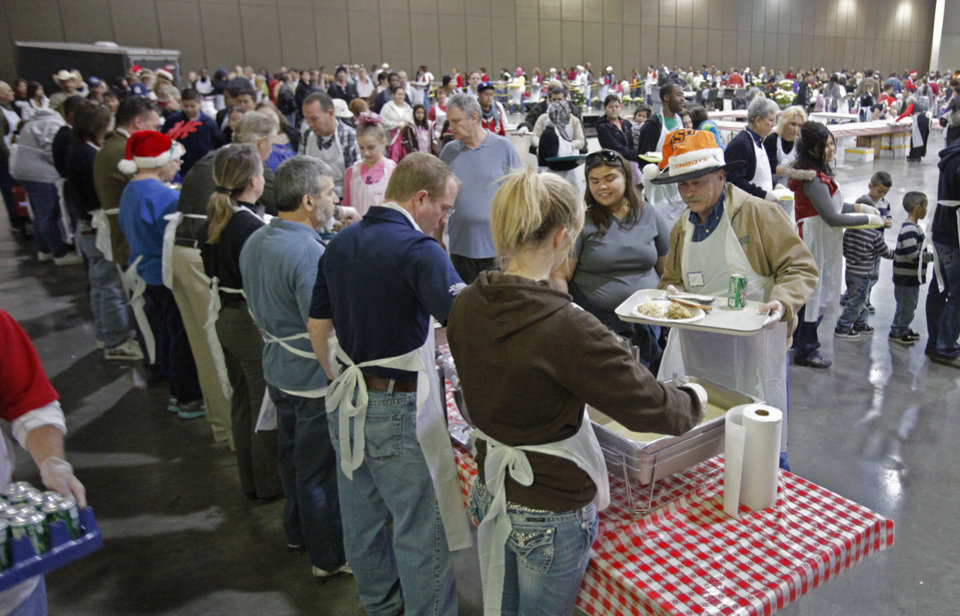 Volunteers serve at the Red Andrews Christmas Dinner on Sunday, Dec. 25, 2011, in Oklahoma City, Okla. Photo by Steve Sisney, The Oklahoman <strong>STEVE SISNEY - THE OKLAHOMAN</strong>