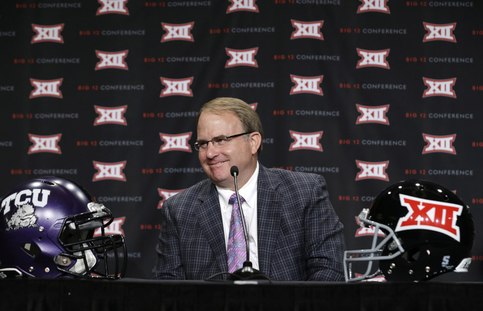 Photo - TCU head coach Gary Petterson smiles as he listens to a reporters question during the NCAA college Big 12 Conference football media days in Dallas, Monday, July 21, 2014. (AP Photo/LM Otero)