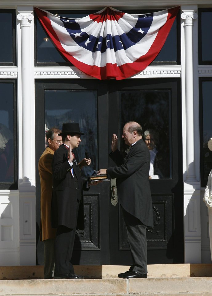 Photo - Edward S. Haskell, descendant of the first governor Charles Haskell, is sworn in as the first governor, on the steps of the Carnegie Library during the Centennial Day celebrations in Guthrie, OK, Thursday, Nov. 16, 2007. By Paul Hellstern / The Oklahoman