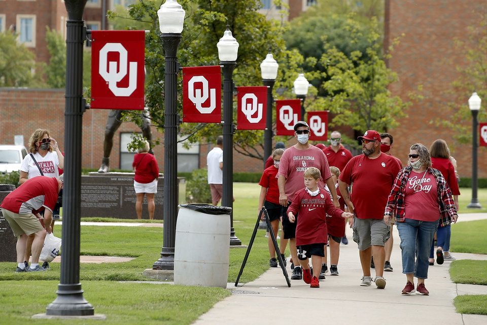 Photo - Oklahoma fans walk on campus before a college football game between the University of Oklahoma Sooners (OU) and Missouri State in Norman, Okla., Saturday, Sept. 12, 2020. [Bryan Terry/The Oklahoman]
