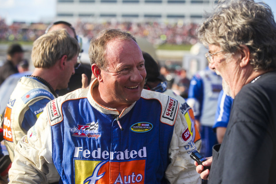 Photo - Ken Schrader talks to the media after winning his qualifying race and set the fastest time in qualifying for Wednesday night's NASCAR Truck Series auto race at Eldora Speedway, Wednesday, July 24, 2013, in Rossburg, Ohio. (AP Photo/Dayton Daily News, Greg Lynch) LOCAL PRINT OUT AND LOCAL TV OUT (WKEF, WRGT, WDTN)