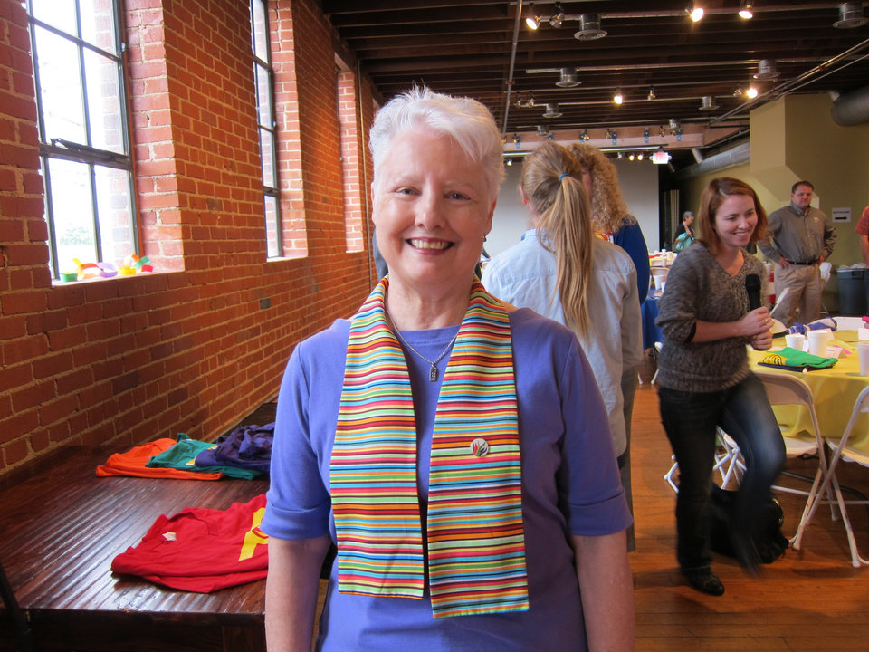 Photo -  Elaine Gragg, wife of the Rev. Jim Gragg, a retired United Methodist minister, models one of the rainbow-colored stoles she created for United Methodists who support full inclusion for the gay community in the life of the United Methodist denomination. Photo by Carla Hinton, The Oklahoman
