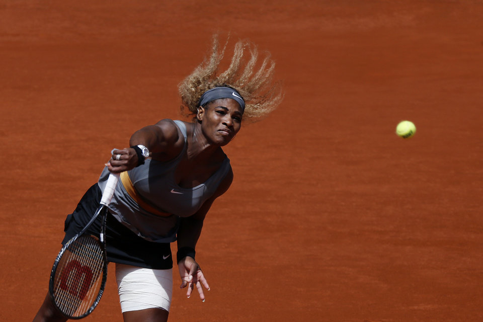 Photo - Serena Williams from the U.S. serves the ball during a Madrid Open tennis tournament match against Carla Suarez from Spain in Madrid, Spain, Thursday, May 8, 2014 . (AP Photo/Daniel Ochoa de Olza)