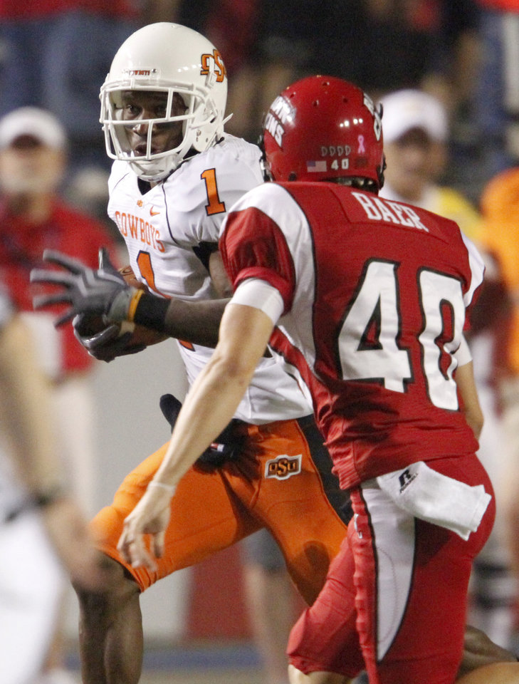 OSU's Joseph Randle tries to get past Louisiana-Lafayette's Brett Baer during the football game between the University of Louisiana-Lafayette and Oklahoma State University at Cajun Field in Lafayette, La., Friday, October 8, 2010. Photo by Bryan Terry, The Oklahoman