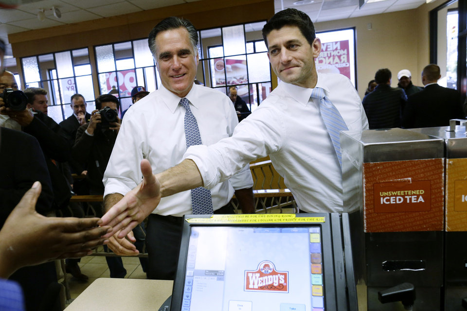 Photo -   Republican presidential candidate, former Massachusetts Gov. Mitt Romney and his vice presidential running mate, Rep. Paul Ryan, R-Wis., make an unscheduled stop at a Wendy's restaurant in Richmond Heights, Ohio, on Election Day, Tuesday, Nov. 6, 2012. (AP Photo/Charles Dharapak