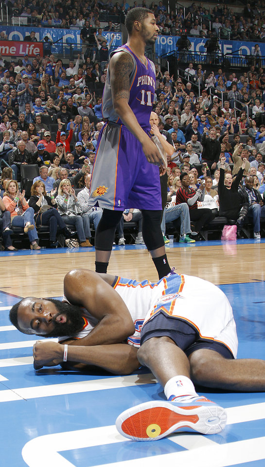 Photo - Oklahoma City Thunder guard James Harden (13) reacts after being fouled by Phoenix Suns forward Markieff Morris (11) during the NBA basketball game between the Oklahoma City Thunder and the Phoenix Suns at the Chesapeake Energy Arena on Wednesday, March 7, 2012 in Oklahoma City, Okla.  Photo by Chris Landsberger, The Oklahoman