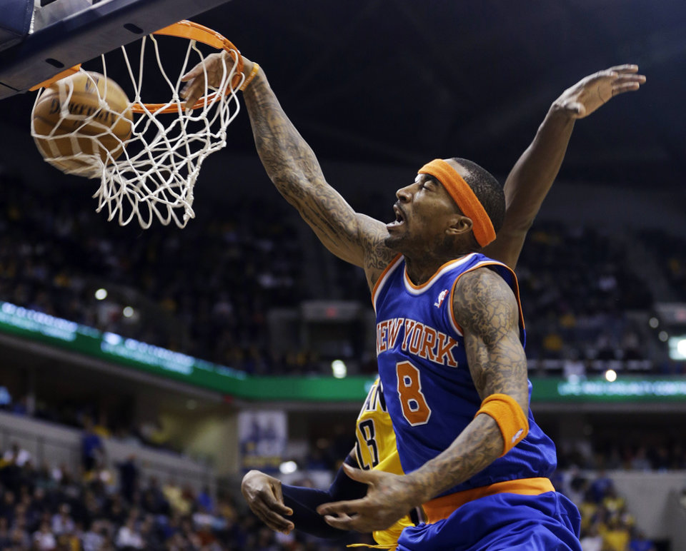 Photo - New York Knicks' J.R. Smith (8) dunks against Indiana Pacers' Ian Mahinmi (28) during the first half of an NBA basketball game, Thursday, Jan. 10, 2013, in Indianapolis. (AP Photo/Darron Cummings)