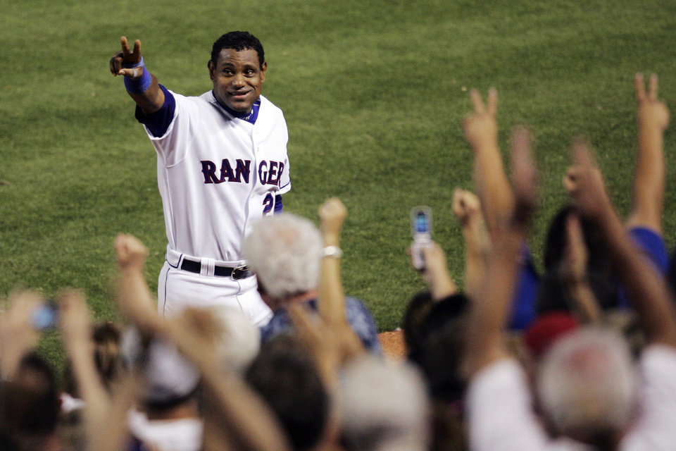 Photo - FILE - In this June 20, 2007, file photo, Texas Rangers' Sammy Sosa acknowledges cheers from fans after hitting his 600th career home run against the Chicago Cubs in a baseball game in Arlington, Texas. Sosa, Roger Clemens and Barry Bonds are set to show up on the Hall of Fame ballot for the first time on Wednesday, Nov. 28, 2012, and fans will soon find out whether drug allegations block the former stars from reaching baseball's shrine. (AP Photo/Tim Sharp, File)