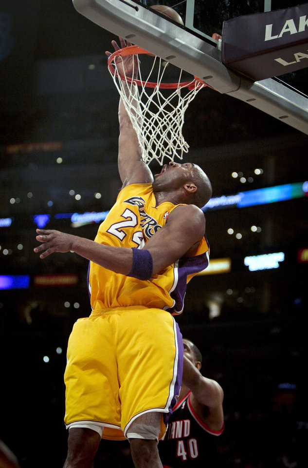 Los Angeles Lakers guard Kobe Bryant lays the ball in over Portland Trail Blazers center Kurt Thomas during the first half on an NBA basketball game, Monday, Feb. 20, 2012, in Los Angeles. (AP Photo/Bret Hartman)