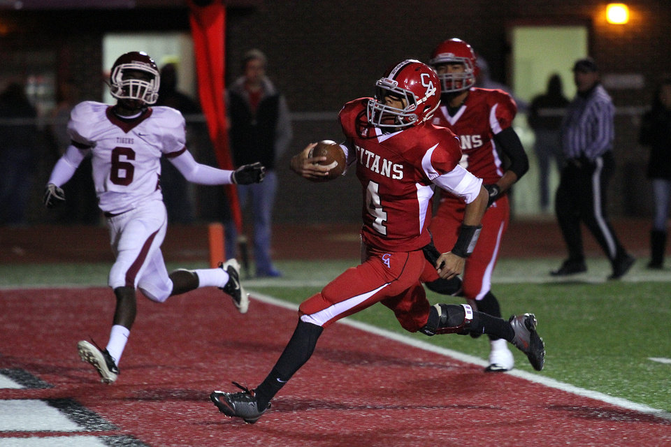 Photo - Carl Albert quarterback Dillan Dansby crosses the goal line for a touchdown during the Carl Albert Titans - Ardmore Tigers football game Friday night at Jim Harris stadium in Midwest City. PHOTO BY HUGH SCOTT, FOR THE OKLAHOMAN