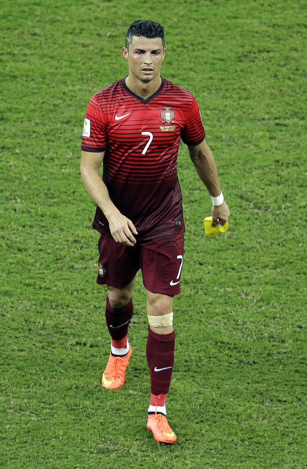 Photo - Portugal's Cristiano Ronaldo leaves the pitch after a 2-2 draw in the group G World Cup soccer match between the USA and Portugal at the Arena da Amazonia in Manaus, Brazil, Sunday, June 22, 2014. (AP Photo/Themba Hadebe)
