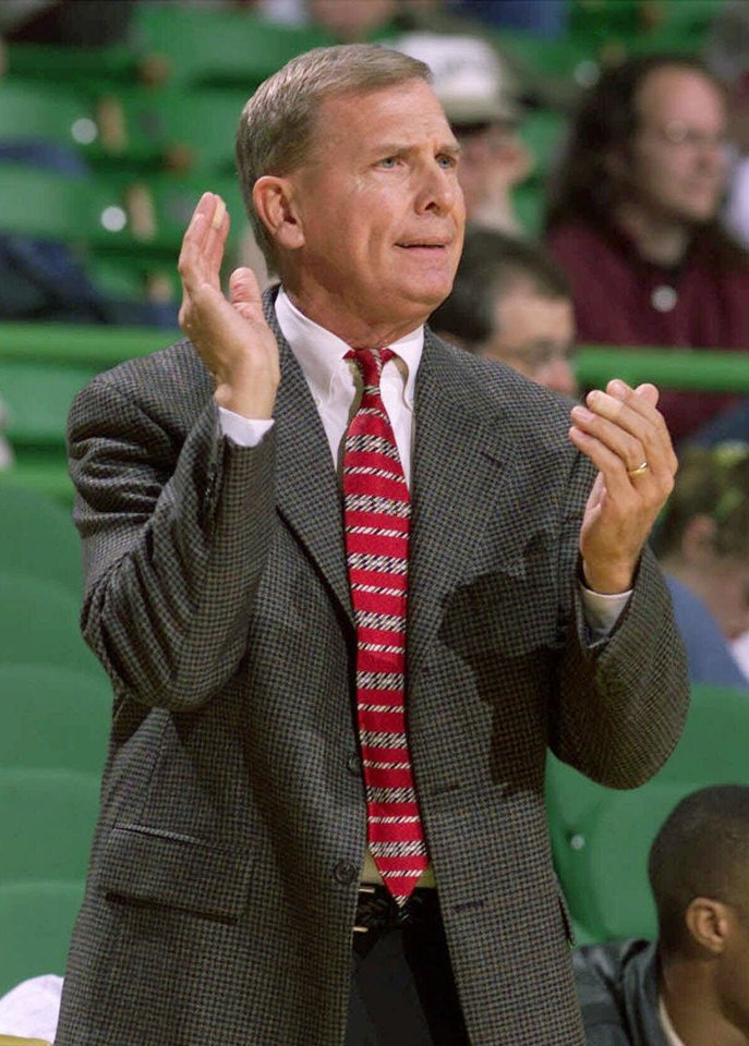 Photo - ** FOR USE WITH COLLEGE BASKETBALL PACKAGE ** FILE ** Baylor head basketball coach Dave Bliss gestures in this Dec. 22, 1999, file photo at the Ferrell Center at Baylor University in Waco, Texas. After a tumultous offseason, the team is looking forward to just playing basketball again. (AP Photo/Waco Tribune Herald, Rod Aydelotte, FILE)