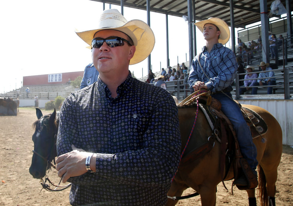 Photo -  Dodge City Community College coach Gabe Burrows watches athletes during the International Finals Youth Rodeo at the Heart of Oklahoma Exposition Center in Shawnee, Okla., Wednesday, July 10, 2019. [Sarah Phipps/The Oklahoman]
