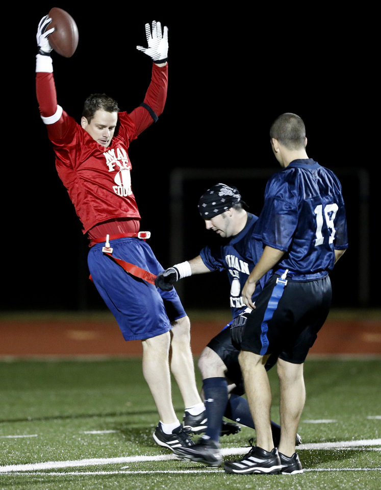 Norman firefighter Blake Taliaferro scores a touchdown Tuesday in the annual Guns and Hoses charity football game between the police and fire departments. This year's game benefits Compassion Pointe, which serves the homeless and victims of domestic violence. PHOTO BY STEVE SISNEY, THE OKLAHOMAN <strong>STEVE SISNEY</strong>