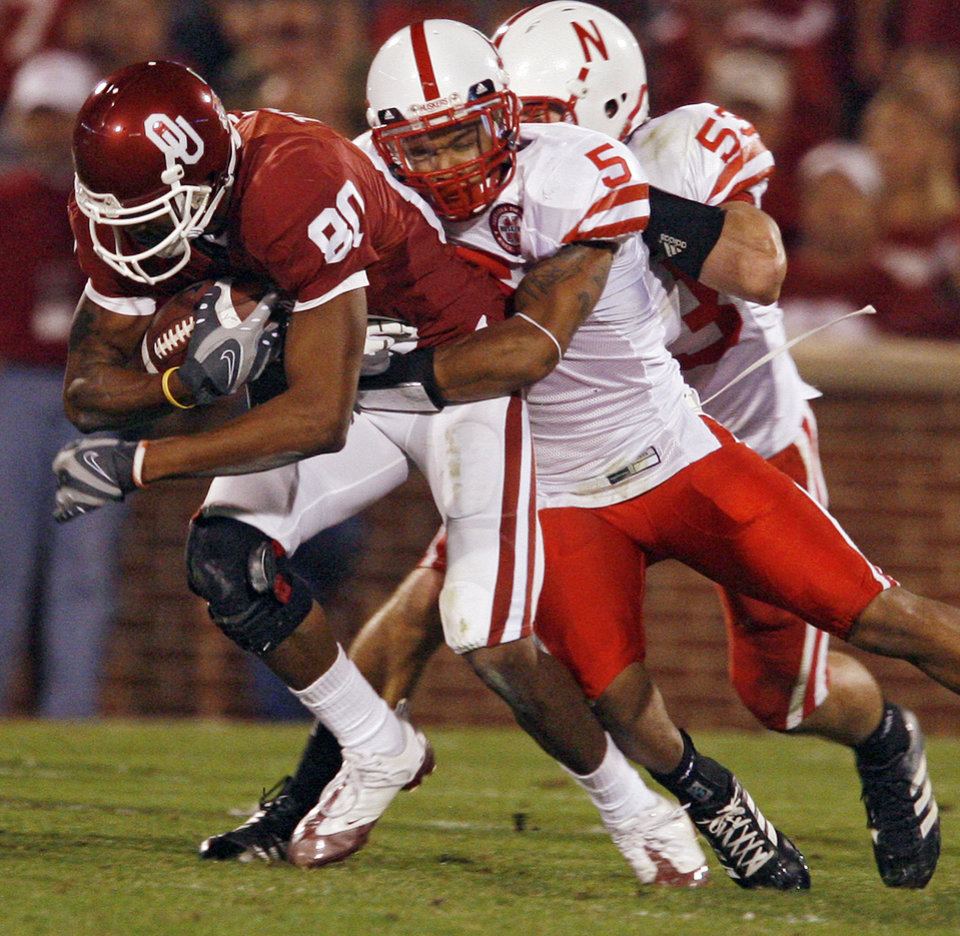 Oklahoma's Adron Tennell (80) is drug down by Nebraska's Anthony West (5) during the first half of the college football game between the University of Oklahoma Sooners (OU) and the University of Nebraska Huskers (NU) at the Gaylord Family Memorial Stadium, on Saturday, Nov. 1, 2008, in Norman, Okla. 