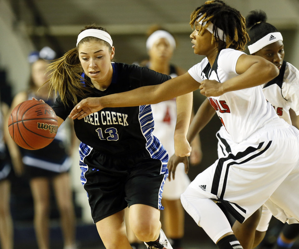 Photo - Deer Creek's Whitney Jones (13) tries to get the ball past East Central's Janee Arnold (3) during the Class 5A girls championship game in the state high school basketball tournament between Deer Creek and Tulsa East Central at the Mabee Center in Tulsa, Okla., Saturday, March 15, 2014. Photo by Nate Billings, The Oklahoman